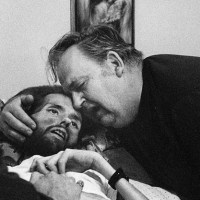 A father comforts his son on his deathbed. The photo that changed the face of AIDS. 1989