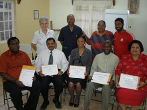 Front Row  - left to right: Hayden Tidd, Sean Julien, Renessa Tang Pack, Nigel Cassimire, Yvette Woodruffe (collected certificate for Cheridan Woodruffe) Back Row  - left to right: Sr Roberta O'Flaherty, Selwyn Bhajan, Leela Ramdeen, Robert Persaud.