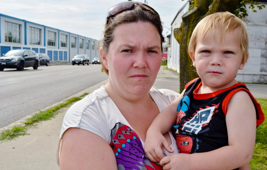 Samantha LeBlanc with her two-year-old son Decklyn Desrochers, who was allegedly poisoned, outside her Kitchener home where it allegedly took place. (Alex Consiglio/Toronto Star)