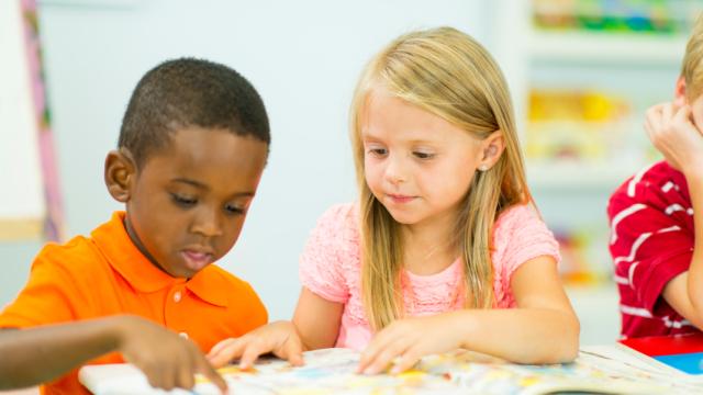 Preschoolers reading books.