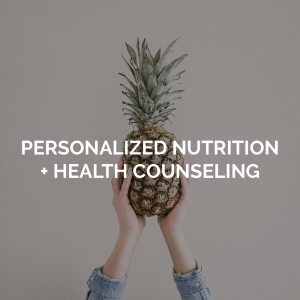Personalized nutrition + health counseling image with person holding up a pineapple