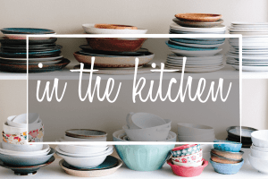 "Image of plates on shelves which says ""in the kitchen"""