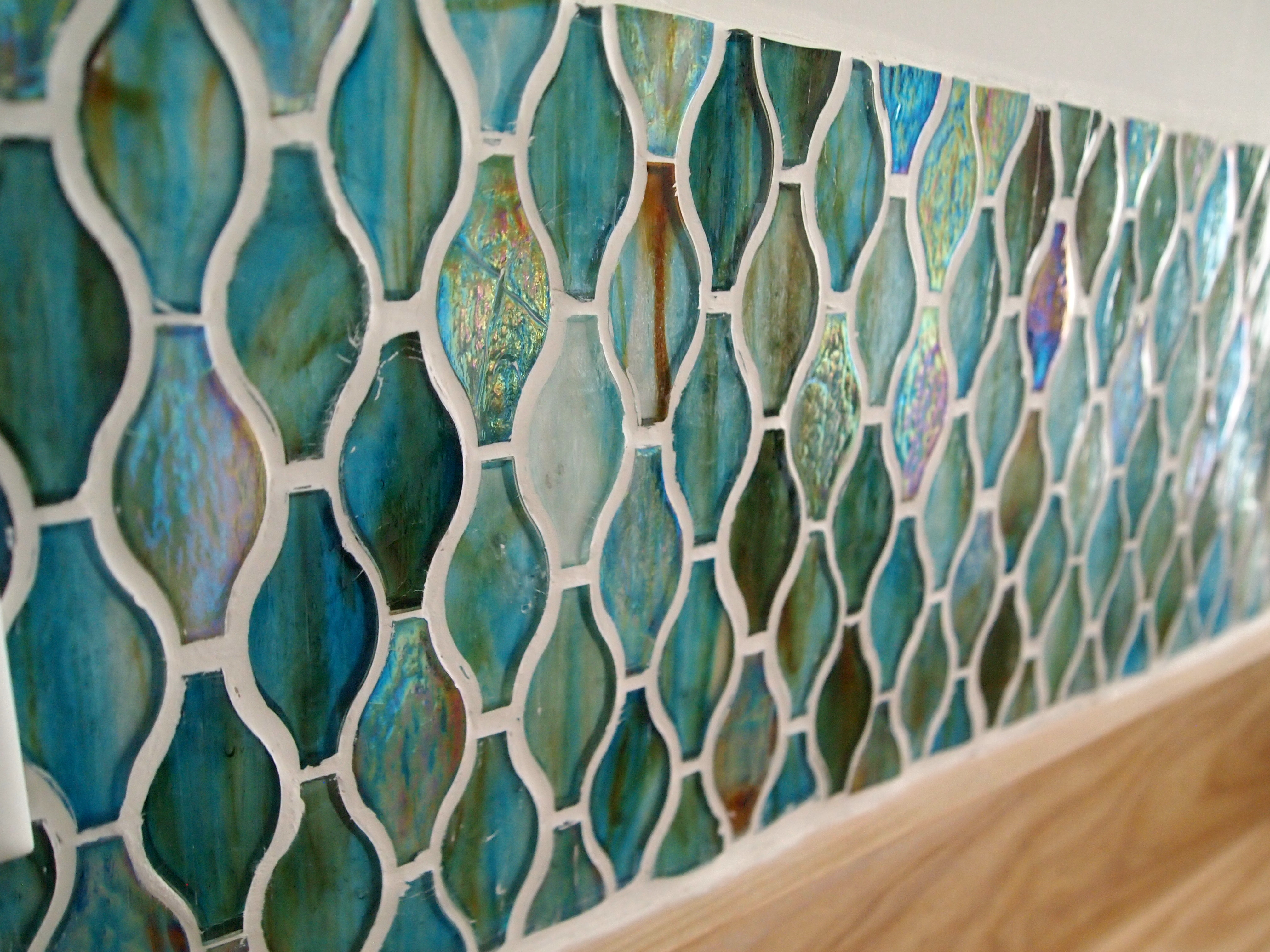 How to install a glass tile backsplash... amazing laundry room transformation Sawdust and Embryos