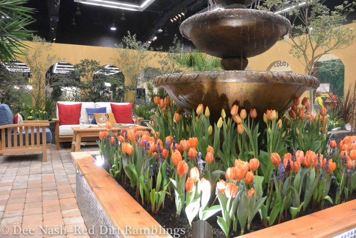 El Patio Fuente, by Treeline Designz 360° Design Company and built by Calluna's Gardens incorporated a lot of tulips and a full sized fountain in its warm-hued design.