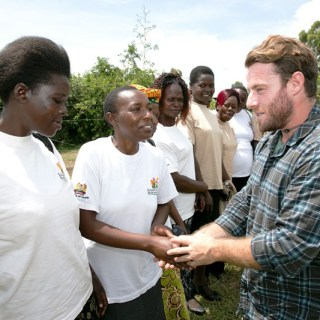 Jake Glaser meeting women who are fighting HIV and AIDS i Kenya when he visited Kenya in 2014. He has been living with HIV for more than 30 years and helping in the fight to eradicate the spread of the virus in children. [Picture: Courtesy]