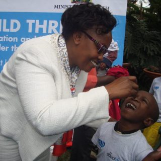 Gladys Mugambi administers vitamin A supplement to a child during the project launch in Nairobi. Photo - Henry Owino