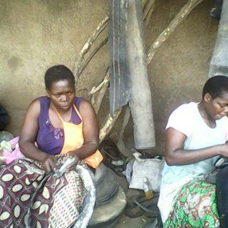 Rosemary Onjiri and her sister Jackline at work near Kibuye market, in Kisumu City. Photo - Oliver Ochieng
