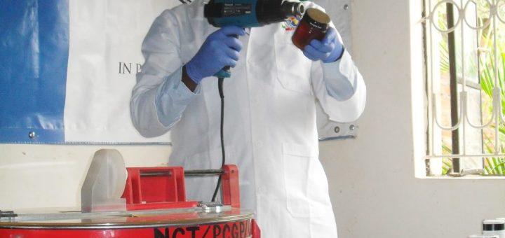 John Kariuki sealing the honey that is later sold to feed vulnerable children. Photo Joyce Chimbi