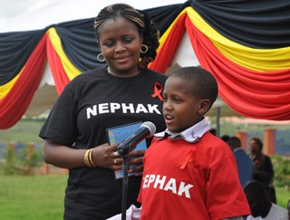 Elijah Zacchary Lamaiyan , a 12-year-old boy who was born HIV positive delivers his speech at the World AIDS Day 2015 commemoration in Machakos, Kenya. He has been in the fore front fighting against stigmatization of HIV positive people .His mother, Evelynn Simaloi, stands beside him.Picture:Courtesy UNICEF