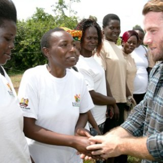 Jake Glaser meeting women who are fighting HIV and AIDS in Kenya when he visited Kenya in 2014. He has been living with HIV for more than 30 years and helping in the fight to eradicate the spread of the virus in children. Picture: Courtesy
