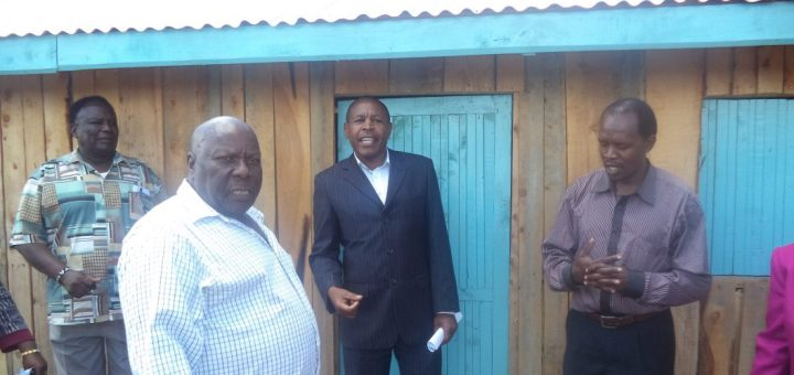 Peter Weru in white shirt at his new home which was built on land donated by his nephew. Picture-Waikwa-Maina