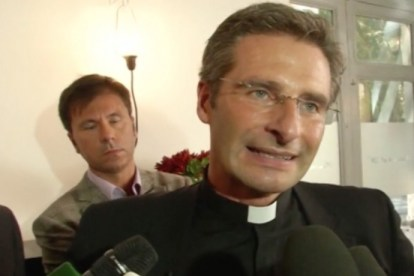 """Father Krysztof Charamsa with his partner Eduard at a news conference this past weekend: """"I am a gay priest. I am a happy and proud gay priest."""""""