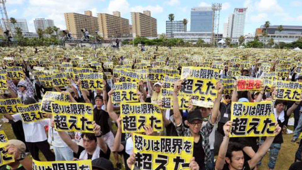 "Tens of thousands gather to protest U.S. military bases in Okinawa on June 19, 2016. The posters read: ""Our anger has exceeded its limit""."