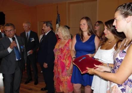 Gilles Claude aux côtés de son épouse Astrid et de leurs enfants.