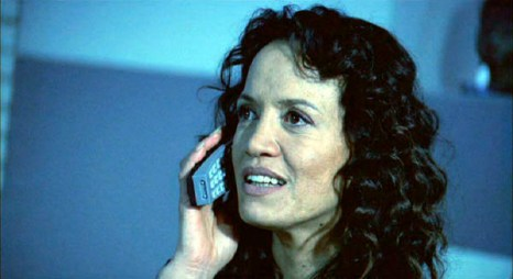 Karina (Rena Owen) on the phone with Kevin (Skeet Ulrich)
