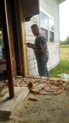My man cutting the hole for a new door and window.