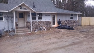 We both hated the old white stucco so Joe (being a stone mason by trade) naturaly wanted to cover it with rock.