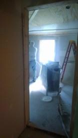 Joe started spraying primer in Dakota's bedroom