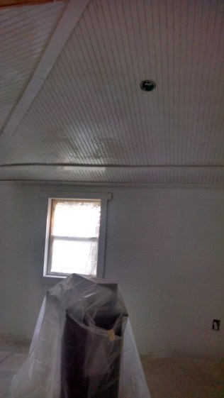 A shot of those awesome vaulted bead board ceilings primed in Dakota's room!