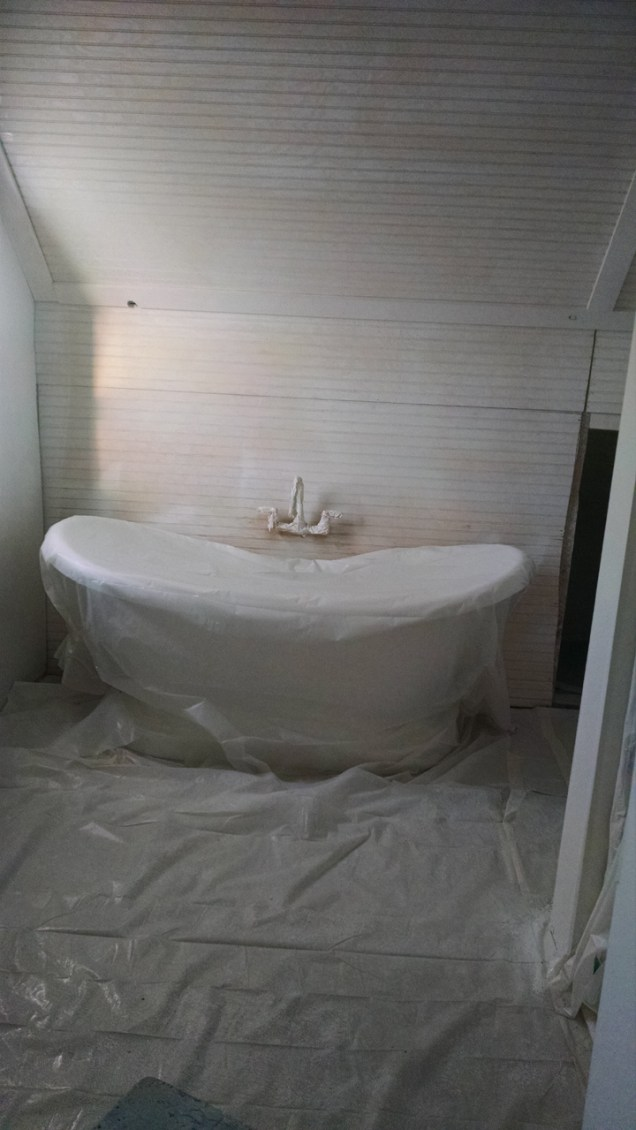 My tub all wrapped up and waiting for paint after Joe primed it!