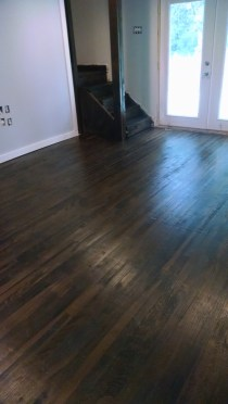Here are the original 100 year old oak floors in our living room covered with dark walnut minwax stain and poly.