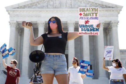 Pro-Life Demonstrators - Sign Reads Health+ Safety Regulation DO NOT EQUAL Undue Burden