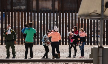 """Border Patrol agents apprehend a group of migrants near downtown El Paso, Texas following the congressional border delegation visit on March 15, 2021. - President Joe Biden faced mounting pressure Monday from Republicans over his handling of a surge in migrants -- including thousands of unaccompanied children -- arriving at the US-Mexican border. Republican Congressman Kevin McCarthy of California, who leads his party in the House of Representatives, told reporters last week the """"crisis at the border is spiraling out of control."""" """"It's entirely caused by the actions of this administration,"""" said McCarthy. (Photo by Justin Hamel / AFP) (Photo by JUSTIN HAMEL/AFP via Getty Images)"""