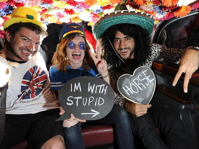 Black Cab Culture owner Ross Elliott, Tayla Durbidge and driver Roland Chlouk pose for the camera installed inside a black ca...