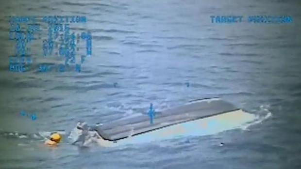 This still image from a Coast Guard video on Sunday shows Austin and Perry's capsized boa