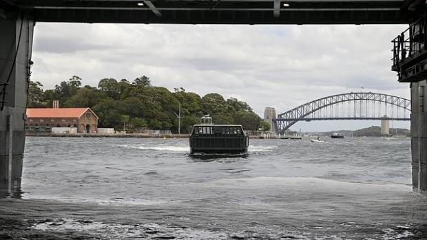 Sea garage ... A landing craft belonging to approaches HMAS Canberra's dock in Sydney Har