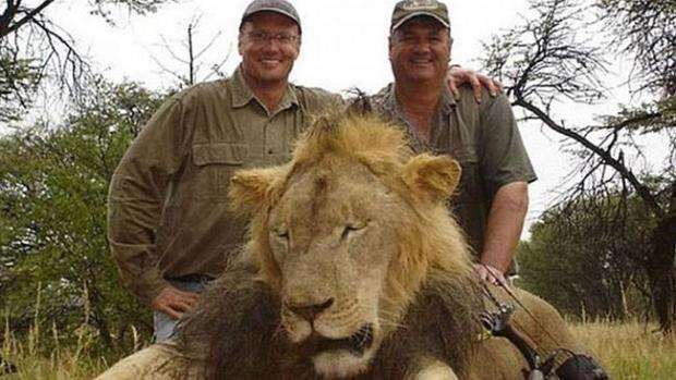 American dentist Walter Palmer, left, poses with a lion.