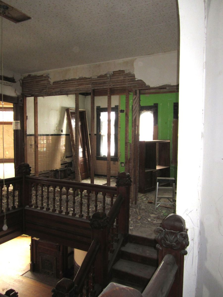 Most of the plaster and lath are now removed, and the triple stained-glass windows on the north wall are, after almost a century, lighting the stair hall once again. Hallelujah.