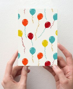 Party greeting card in hands
