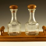 Well-preserved Mid-Century Modern teakwood condiment set made of genuine teakwood and Italian glass.