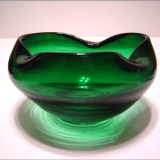 A lovely hand blown deep green glass rose bowl.