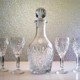 A lovely old Depression crystal decanter and cordial set. Circa estimated 1920's - 1940's.