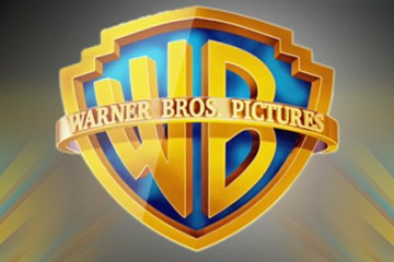 Revista actitud Warner Bros logo