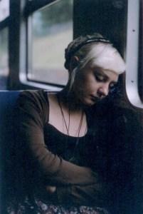 sleeping_in_a_train__by_ookami_zone-d46eg0v