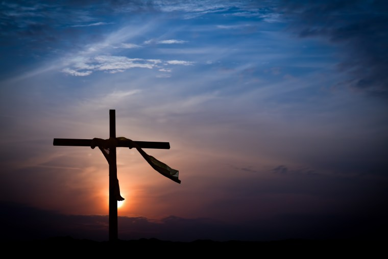 Dramatic Easter Sunrise Lighting and Christian Cross