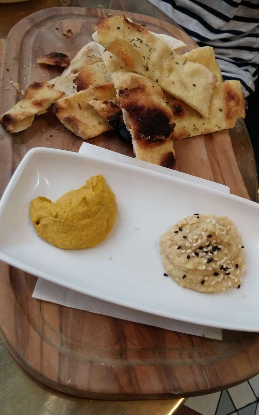 Flatbread + dips: L > R; carrot and toasted cumin, hummus