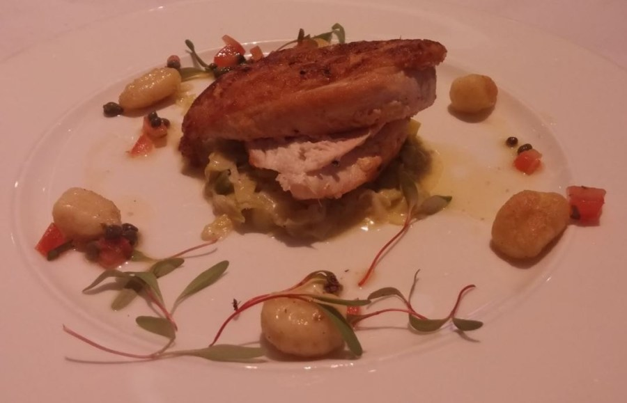 Roast chicken breast, creamed leeks, tomato and caper dressing, fried gnocchi.