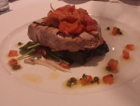 Chargrilled tuna steak, peperonata, spinach leaves, tomato and caper dressing.