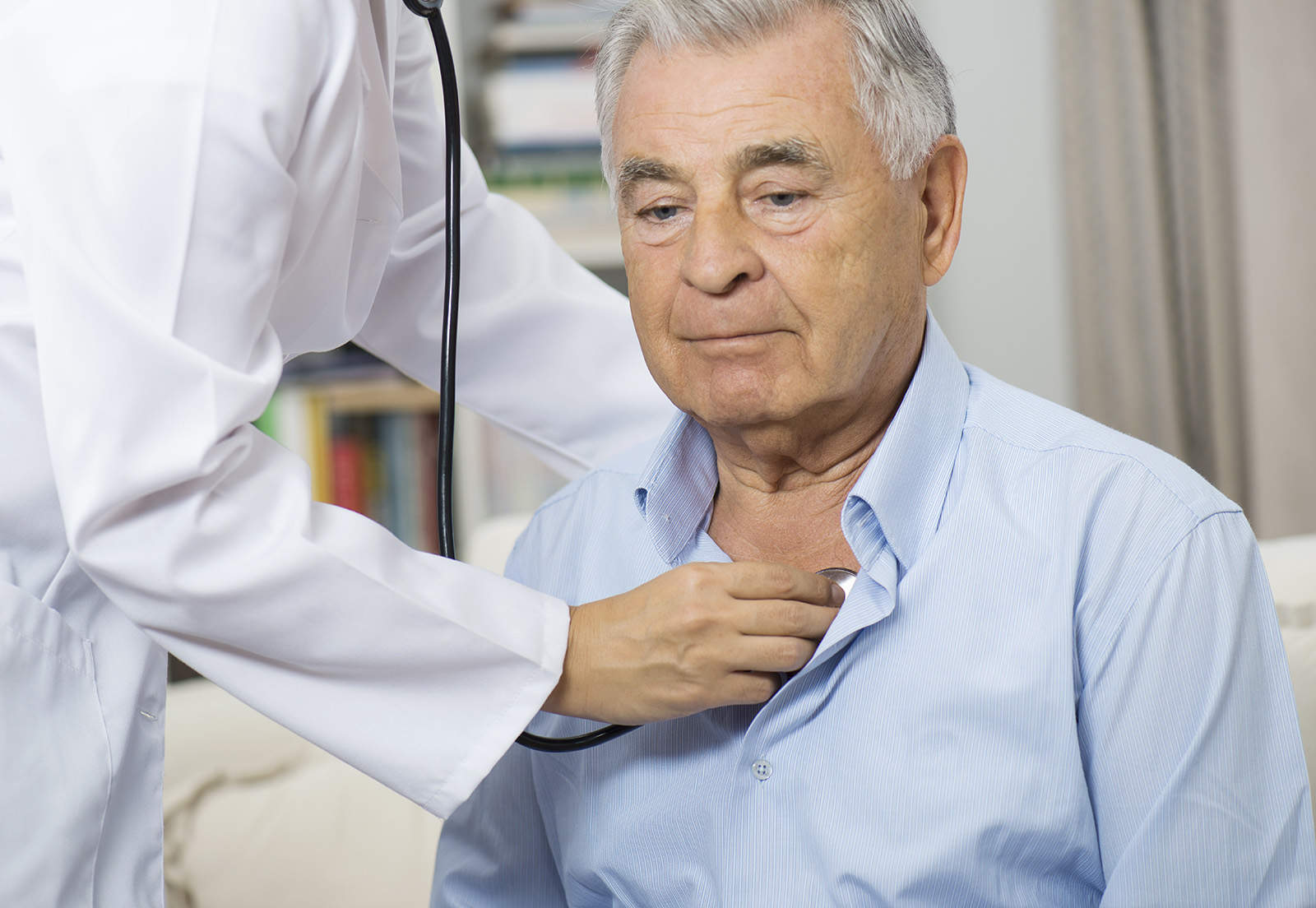 Medical Caring For Senior Man At Home