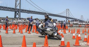 Corporal Quinn Redeker of the Ventura Police Department competing at the Third Annual International Police Motorcycle Skills Competition, held in San Francisco, California, on August 1, 2015. Negotiating tight cone patterns with speed and precision requires remarkable clutch and throttle control, excellent balance and laser-like focus. (Photography by the author)