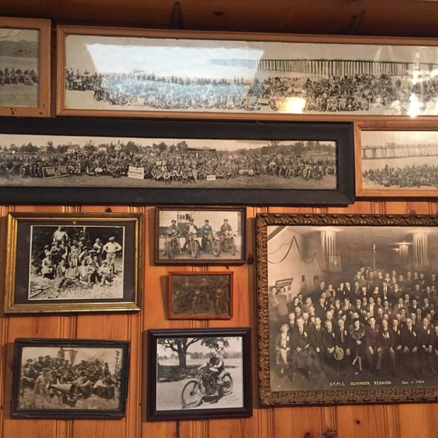"""The San Francisco Motorcycle Club's clubhouse in the Mission District of San Francisco is rich with history. The wood-paneled walls are covered with old photographs, banners and trophy cases with awards recognizing achievements such as """"Best Uniformed Club, 1936."""" (Photo: Christina Shook)"""