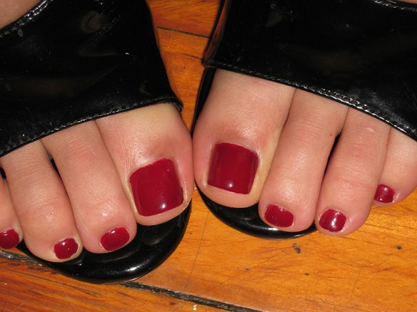 Excellent foot fetish shot: smooth, soft, and perfectly painted blood-red toenails,