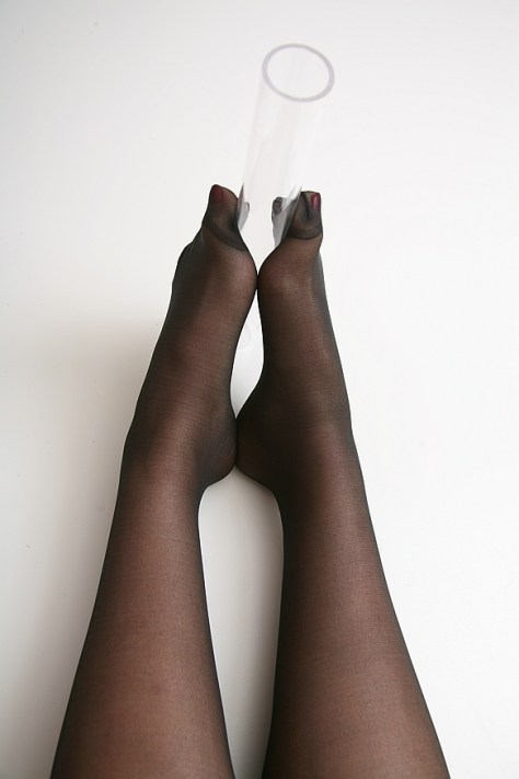 Lady Clarece demonstrates a footjob in stockings