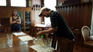 Stuart pouring champagne.