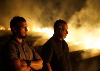 Close up of Retired Detective Rhodes Sanchez and Detective Aubrey St. Angelo at burning sugar cane field.
