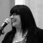 Joan H at the mic